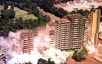 Image of a building collapsing from demolition